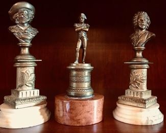Small bronze busts on marble bases