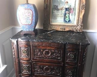Antique four drawer carved chest with black marble top