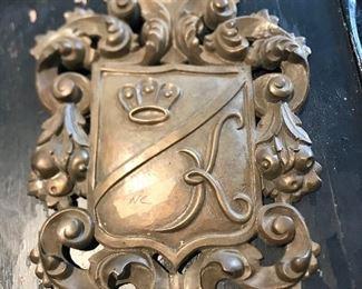antique bronze crest wall plaque