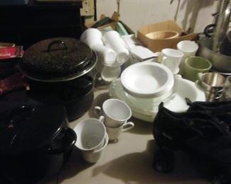 plateware, coffee mugs, roller skates, large pot