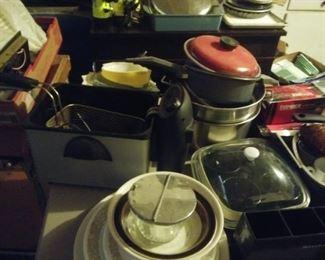 cookware, deep fryer, baking dishes, mixing bowls, pots