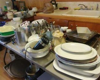 kitchen items, plates, baking pans, silverware,