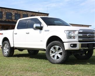 """Lot #97: 2015 Ford F-150 Platinum Edition with 3.5L Ecoboost V6, SuperCrew, Fabtech Lift with 37"""" Tires. 74,857 Miles."""