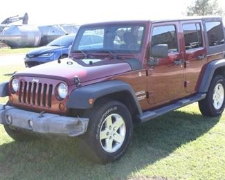 #95: 2012 Jeep Wrangler 4-Door. 4WD. V6 Gas Engine. 77,011 Miles. VIN: 1C4BJWDG3CL143012