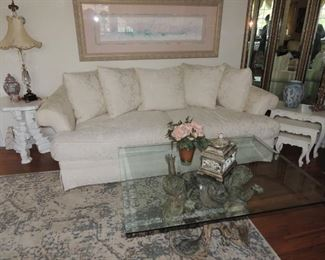 white brocade deep sofa. a few years old. Don't be afraid of white scotch guard yearly!