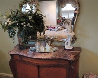 antique French marble top commode and antique mirror,  Armani ballerina, floral arrangements