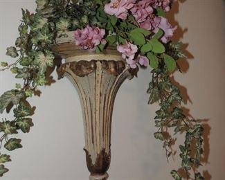 corbel shelf with floral arrangement