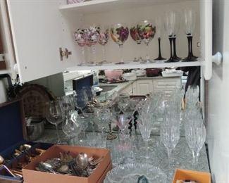 Silver plate flatware, crystal goblets