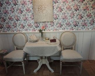 vintage drop leaf table with four upholstered chairs