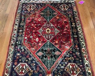 Hand knotted wool rug. Professionally cleaned.