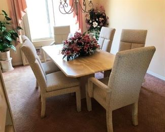 Marble topped dining set with 6 upholstered chairs