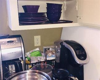 small kitchen appliances, unused dishware, pots