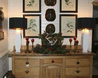 Antique Pine server from France decorated for the holidays with deer antlers, pine cones, greens and berries.