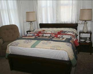 QUILTS ON ANTIQUE OAK BED