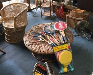 Vintage tennis rackets and baskets.