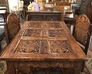 carved wood vintage table and chairs, rug, buffet, stone art