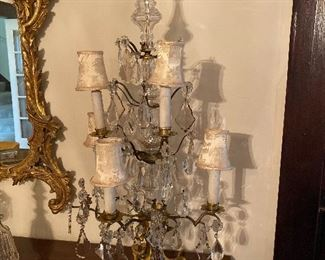 Pair of five-light girandoles, metal frames with drop crystals, early 20th century.