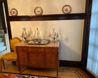 Louis XBI style commode, with marble top, three drawers, musical trophy marquetry inlay, circa 1900.