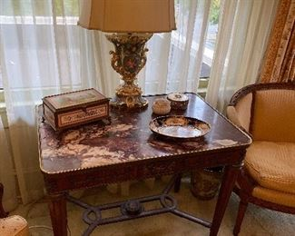 Louis XVI style table, with marble top and gilt brass mounts, circa 1900.