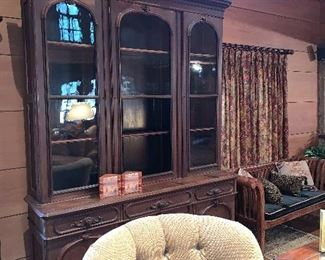 Large antique breakfront with writing desk.