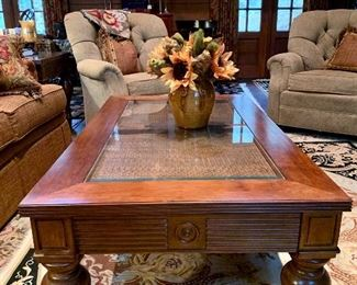 Bassett Furniture - coffee table with two matching end tables. Great turned wooden legs with casters, glass atop rattan.