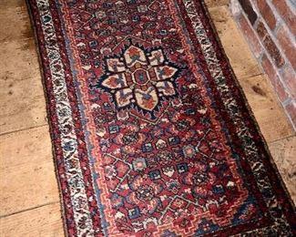 Older Persian scatter rug
