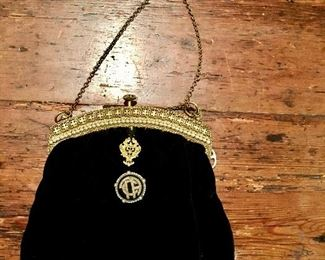Black velvet evening purse, France 1920s with onyx and pearl medallion on gold-tone hardware. Formerly the provenance of MET.
