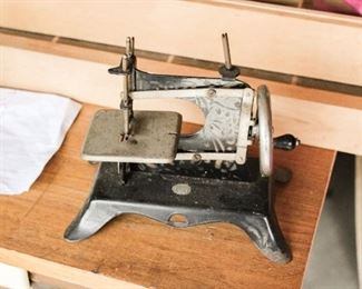 Small metal sewing machine.