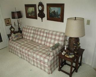 Plaid sofa, nesting tables, lamps and home decor