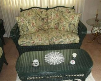 Wicker loveseat and coffee table
