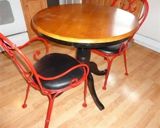 CUTE PEDESTAL TABLE AND RED WROUGHT IRON CHAIRS