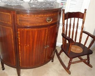Half round buffet table and child's rocking chair,