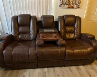 Reclining Sofa with plugs for phone chargers and cup holders