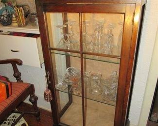 Petite curio cabinet