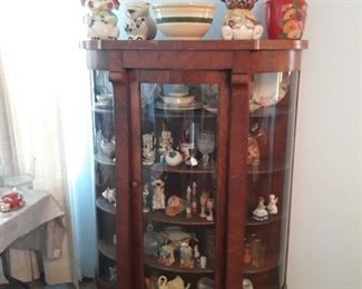 Beautiful curved glass antique cabinet.