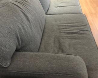 "Grey fabric sofa. 82"" length."