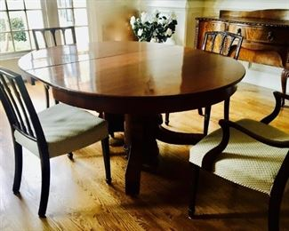 "ANTIQUE MAHOGANY DR TABLE FROM ENGLAND, INCLUDES (SIX) 12"" LEAVES, SEATS UP TO 14-16. *AS SHOWN IN PHOTO WITH ONE 12"" LEAF, OVAL SHAPE, 54W X 65L. WITHOUT LEAVES, 54"" ROUND"