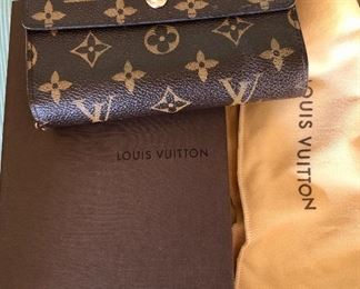 Brand new Louis Vuitton Wallet - never used. Great for a holiday gift!