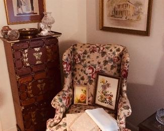 Comfortable wingback with Queen Anne legs. Oriental chest that breaks into three pieces