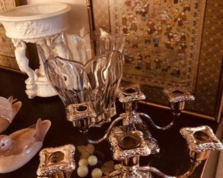 Beautiful silver plate candlesticks next to modern glass bowl and check out the cherub pedestal compote in back