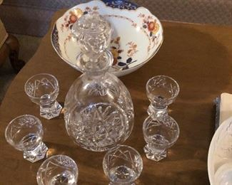 One of two very nice cut glass decanters with glasses