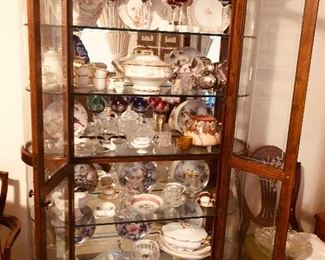 A large display cabinet that lights. Filled with Antiques and collectibles