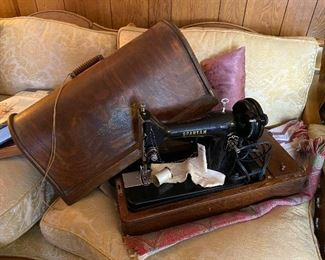 Singer Spartan Sewing Machine with original box and key and spar parts. Antique and beautiful.
