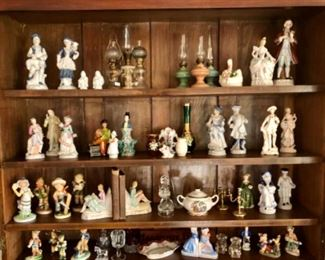 Miniature lamps, porcelain book ends, Hummel, china and brass collectibles.