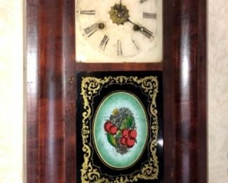 Very nice late 1800's empire style clock with original glass panel.