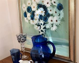 Daisy painting and cobalt blue items