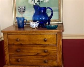 Broyhill silverchest, original canvas Daisy Painting with antique glassware.