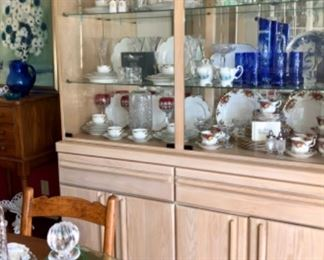blond oak chine cabinet with glass top display space.