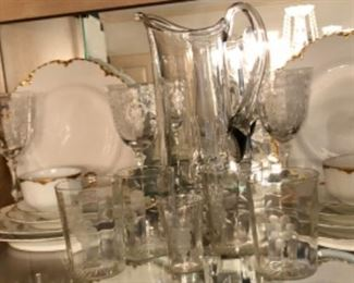 Optic glass etched stems and French Haviland china with gold trim.
