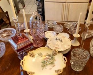Table top shown with hand painted china, brilliant cut glass pieces and crystal candle sticks.
